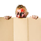 Ghoul peeking. A woman in ghoulish undead make up peeking from behind a cover Stock Photos