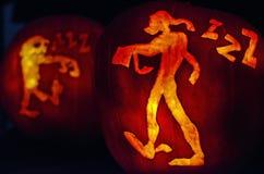 Ghoul Pumpkin Carving. Macro shot of two pumpkin carvings Royalty Free Stock Photos
