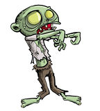Ghoulish zombie. Cartoon illustration of a ghoulish undead green zombie in tattered clothing with a skull-like face and cavernous glowing eyes for your Halloween Stock Photo
