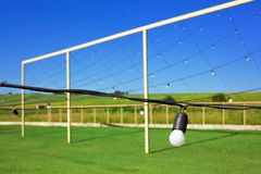 Light bulbs hanging in the row, blue sky, green lawn stock images