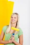 Giallo della parete della pittura della donna Fotografia Stock Libera da Diritti