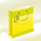 Giallo di carta del pacchetto con un contorno verde oliva per i fes Fotografia Stock Libera da Diritti