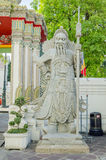 Gian stone statue at wat pho. BANGKOK,THAILAND - JULY 3: gian stone statue at wat pho, July 3, 2014 in Bangkok,Thailand Royalty Free Stock Photos