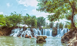 Giang Dien Waterfall, Dong Nai, Vietnam the old trees. Giang Dien Waterfall, Dong Nai, Vietnam on the tree with silky waterfall flowing down many floors are Royalty Free Stock Photo
