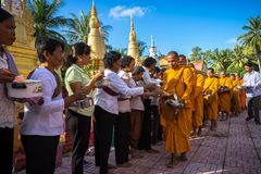 An Giang, Vietnam - Dec 6, 2016: Buddhist monk in south of Vietnam stand in a row waiting people put rice and food offerings in th. Eir alms bowl in Chau Doc Royalty Free Stock Photos