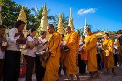 An Giang, Vietnam - Dec 6, 2016: Buddhist monk in south of Vietnam stand in a row waiting people put rice and food offerings in th. Eir alms bowl in Chau Doc Royalty Free Stock Photo