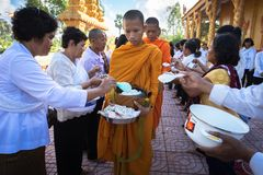 An Giang, Vietnam - Dec 6, 2016: Buddhist monk in south of Vietnam stand in a row waiting people put rice and food offerings in th. Eir alms bowl in Chau Doc Stock Images