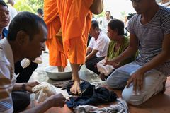 An Giang, Vietnam - Dec 6, 2016: Queue of barefoot monks with foot wash ceremonial in south of Vietnam stock photo