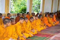 An Giang, Vietnam - Dec 6, 2016: Young monks in temple at ordination ceremony that change the Vietnamese young men to be adult.  stock photography