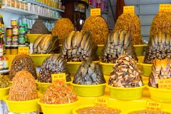 An Giang, Vietnam - Nov 29, 2014: Dried fish with salt and spice added, the popular food for rural people in Mekong delta, south o. F Vietnam, on sale in a shop stock images