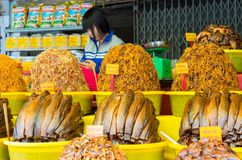 An Giang, Vietnam - Nov 29, 2014: Dried fish with salt and spice added, the popular food for rural people in Mekong delta, south o. F Vietnam, on sale in a shop royalty free stock photography
