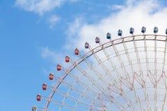 Giant amusement funfair ferris wheel on blue sky. Background Stock Photo