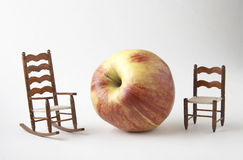 Giant apple or small chairs? Royalty Free Stock Images