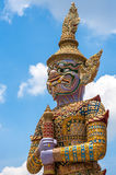 Giant in art on blue sky. Wat Phra Kaew, Bangkok, Thailand Stock Photography