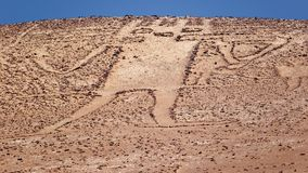 Giant of the Atacama, large petroglyph on a mountain in the Atac. Ama desert, in the Tarapaca region of northern Chile Stock Image