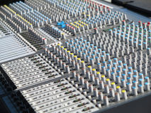 Giant audio sound mixer with color buttons and sliders Stock Images
