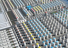 Giant audio sound mixer with color buttons and sliders Stock Photo
