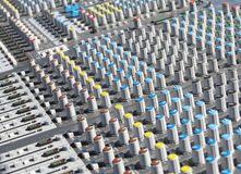 Giant audio sound mixer with color buttons and sliders. Giant audio sound mixer console with color buttons and sliders Royalty Free Stock Photography