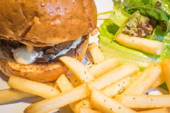 Giant Beef Cheese burger with fries salad. Giant Beef Cheese burger with fries and salad Stock Photo