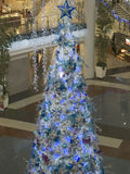 Giant blue christmas tree. Giant blue tinged christmas tree on display to the public Royalty Free Stock Photography