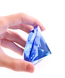 Giant blue diamond in hand Royalty Free Stock Photos