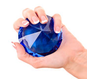 Giant blue diamond in hand isolated Stock Photos