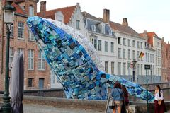 Giant blue whale jumps out of the canal in Bruges stock images