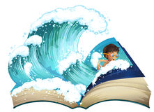 Giant book with boy swimming in the ocean Stock Image