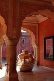 Giant bottle for water. Giant silver bottle for water in pink palace in Jaipur, India Stock Photos