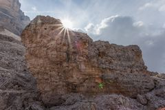 Giant boulder with the back of the sun stock image