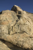 Giant boulder and deep blue sky along the Connecticut coast. Royalty Free Stock Photography