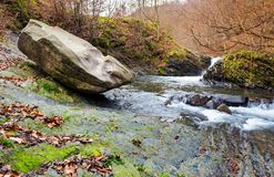 Giant boulder and small cascade on the river. Lovely autumn scenery of Carpathian nature. location near the village Lumshory, TransCarpathia, Ukraine Stock Photo