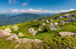 Giant boulders on a grassy slope. Summer scenery of Polonina Runa mountain ridge Royalty Free Stock Photography