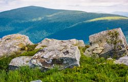 Giant boulders on grassy slopes of Polonina Runa. Beautiful summer scenery in Carpathian mountains with gorgeous cloudscape Stock Image