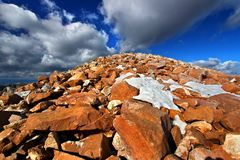 Medicine Bow Peak Landscape Wyoming. Giant boulders and patchy snow at the rugged summit of Medicine Bow Peak in Wyoming stock photo
