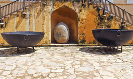 Giant Bowls On Amer Fort. Giant size iron bowl used by royals displayed in Amer Fort.Jaipur,Rajasthan. Amer Fort was built by Raja Man Singh I and located high royalty free stock photo