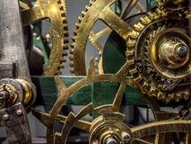 Giant brass clock mechanism. Giant brass clock cogwheel mechanism Stock Photo