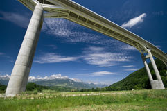 Giant bridge and the Alps Royalty Free Stock Photos