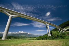 Giant bridge and the alps Royalty Free Stock Images