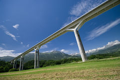 Giant bridge and the Alps Stock Image