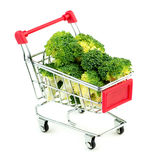 Giant broccoli bunches in market shopping store cart isolated on Stock Photography