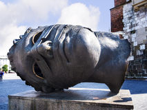 Giant Bronze Head by the Tower of the Old Town Hall in  Krakow Poland Royalty Free Stock Photo