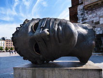 Giant Bronze Head by the Tower of the Old Town Hall in  Krakow Poland Royalty Free Stock Image