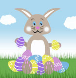 Giant brown chocolate easter bunny with eggs blue sky and green grass spring illustration Royalty Free Stock Photo