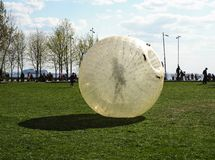 A giant bubble balloon for outdoor inflatable games with a person inside it, zorbing, Saint Petersburg, Russia. Editorial stock images