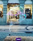 Giant bubble colorful downtown portugal royalty free stock image