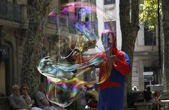 Giant bubbles on the street. A disguised man make soap giant bubbles in the streets of palma de Mallorca as a way to get some cash from tourist and surprised Stock Photography