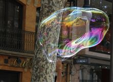 Giant bubbles on the street. Soap giant bubbles in the streets of palma de Mallorca as a way to get some cash from tourist and surprised nearby people Royalty Free Stock Images