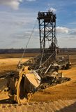 Giant bucket wheel excavator. Taking away the layers of ground before digging the brown coal Stock Images