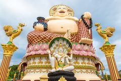 Giant Budai or Pu-Tai or Happy Buddha or Laughing Big Buddha statue at Wat Plai Laem Temple in the Samui island in. Giant Budai or Pu-Tai or Happy Buddha or royalty free stock photos
